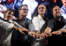 "Candidates Forcadell, Catalonia's President Mas, Romeva and Junqueras put their hands together during a rally presenting the candidates of coalition of Catalan Pro-independence parties and civil societies ""Junts pel si"" in Barcelona"